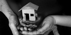 b&w house in hands